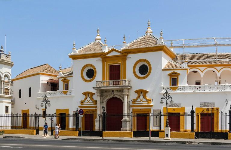 """<a href=""""https://pixabay.com/en/seville-spain-bullring-entrance-85863/"""">Seville's beautiful bullring   © tpsdave/Pixabay</a>"""