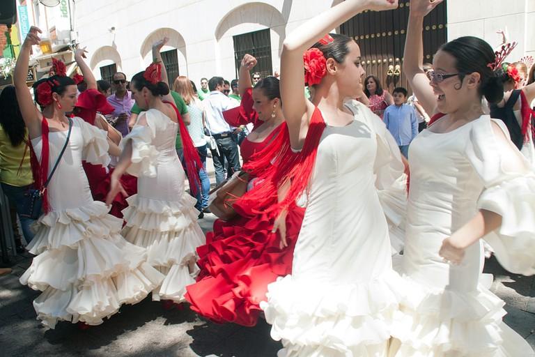 Women performing a Sevillana Dance in the Street, Spain