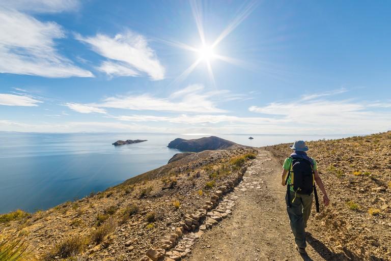 https://www.shutterstock.com/image-photo/backpacker-exploring-inca-trails-on-island-360461885?src=18PRPPo-gYin6w2U7yC5gw-1-3