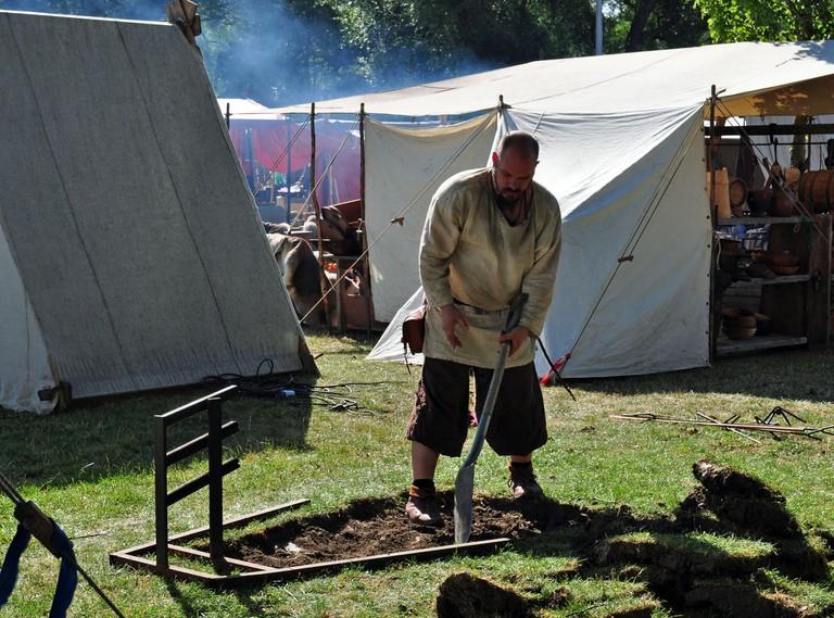 A Viking burying his battle axe