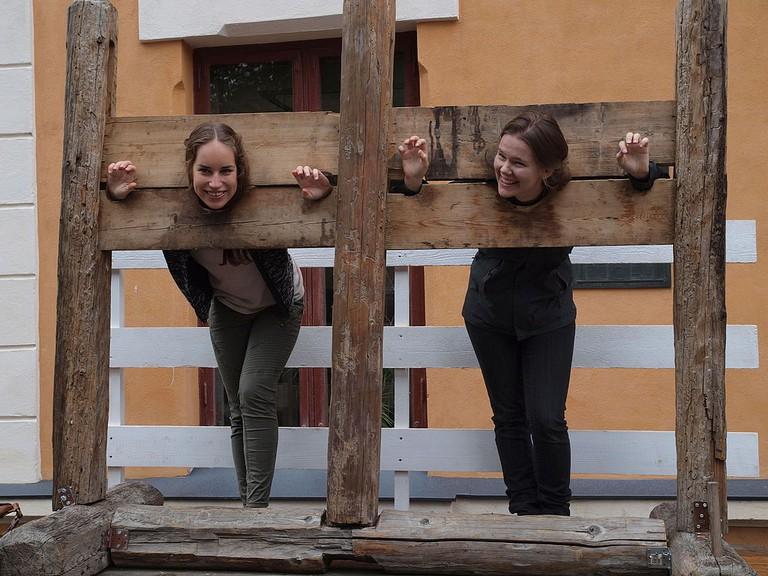 Women in stocks at Turku Medieval market 2015