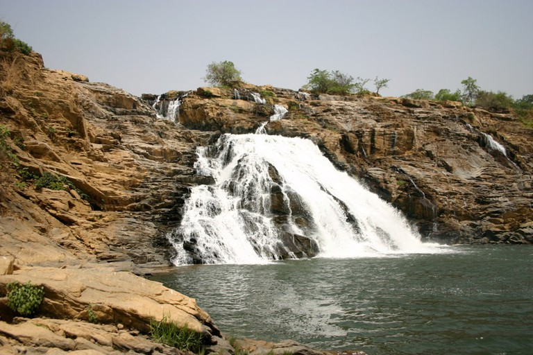 A view of Gurara Waterfalls from the river