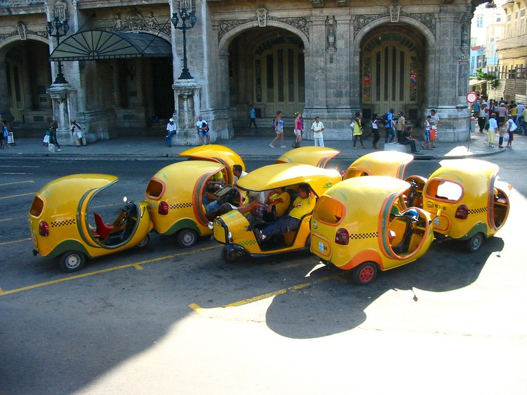 Coco-taxis parked in Paseo Avenue, Old Havana
