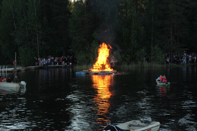A group bonfire on the water/ Visit Lakeland/ Flickr