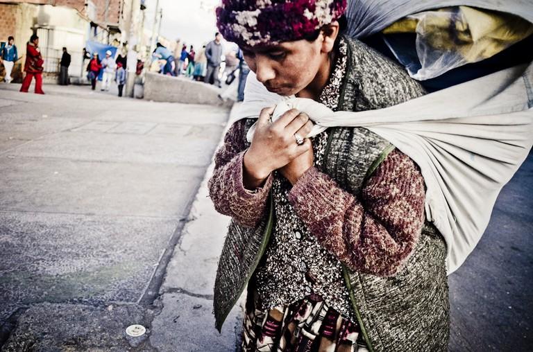 Aymara woman carrying wares