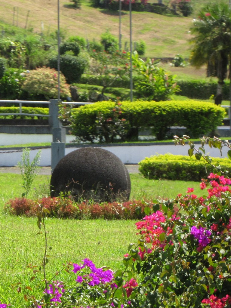 Stone sphere functioning as a lawn ornament