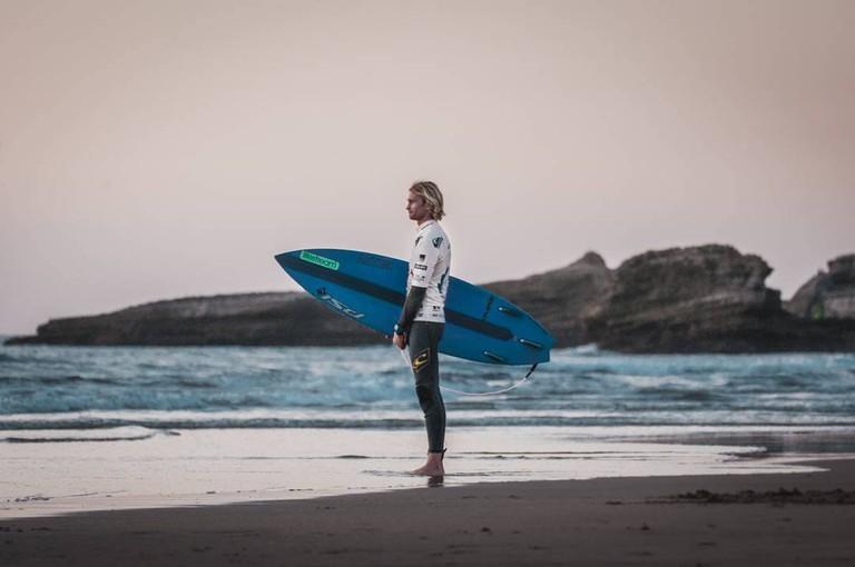 Surfer in Biarritz beach