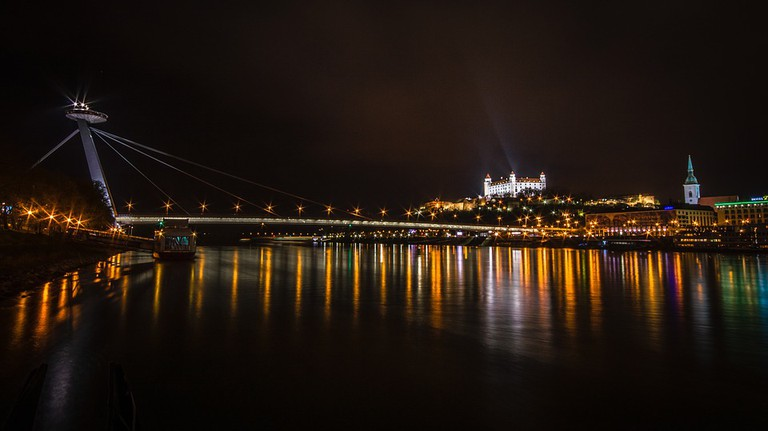 The Bratislava Castle (right) and the UFO Tower (left) face each other across the Danube River I