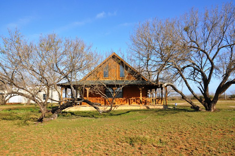 Enjoy your morning coffee on the log cabin's wrap around porch