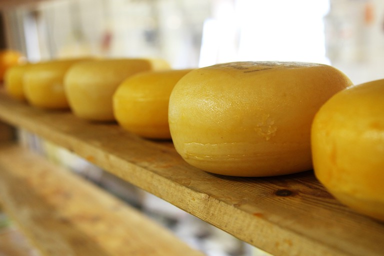 Sample some delicious Dutch cheese after exploring Amsterdam by tuk tuk