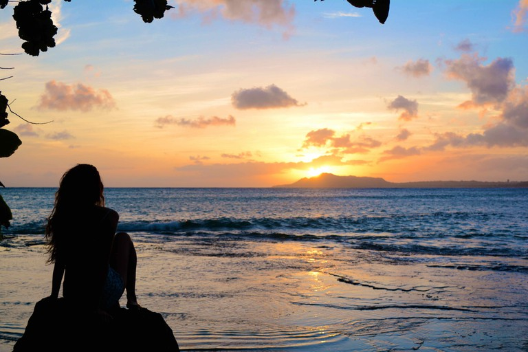 Watching sunset over Diamond head from lower China walls