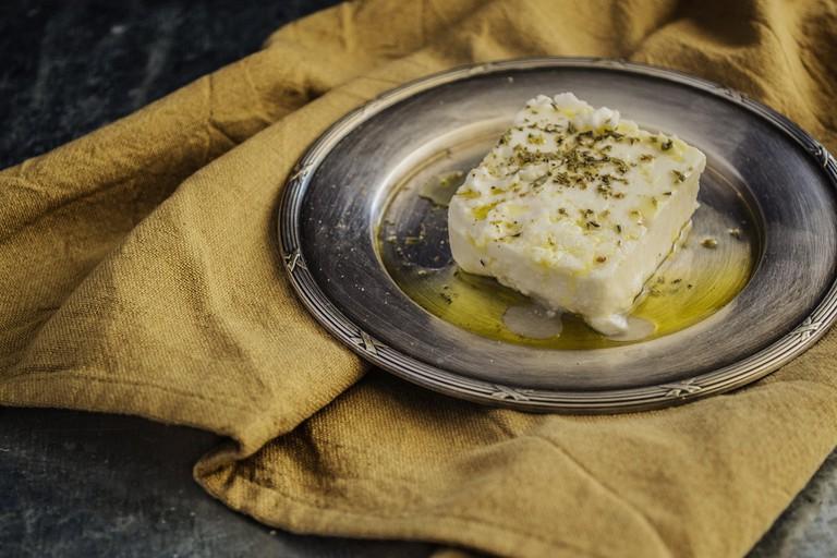 Feta cheese bathing in oil
