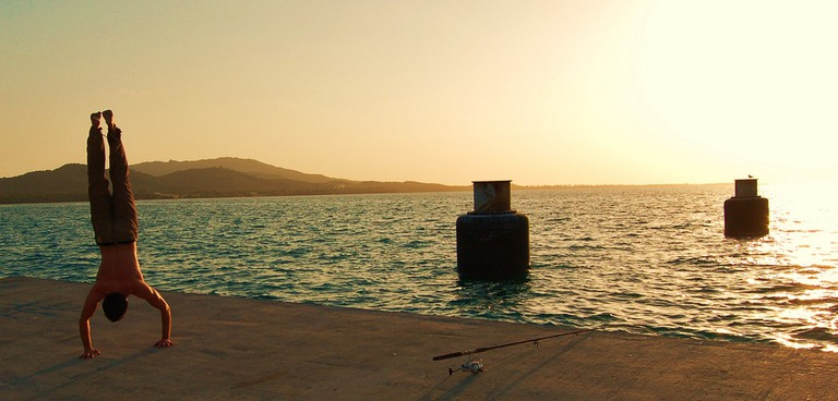Fishing and flipping at a pier in Vieques