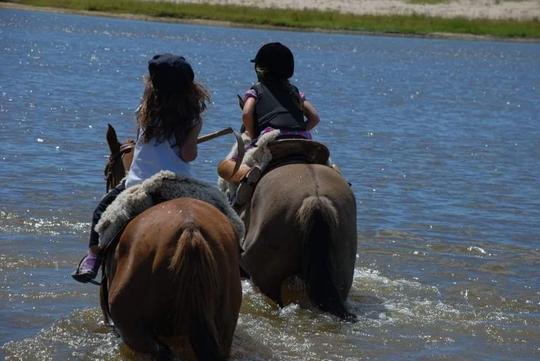 Little girls on horseback with Gaucho Argentina