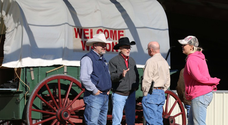 The Welcome Wagon greets visitors to the Cowboy Church of Ellis County