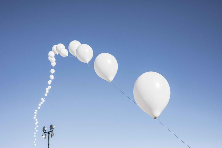 Balloons, which changed colors each day, were a staple of festival