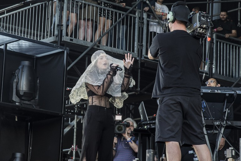 Lorde starting her set veiled and singing directly into the camera