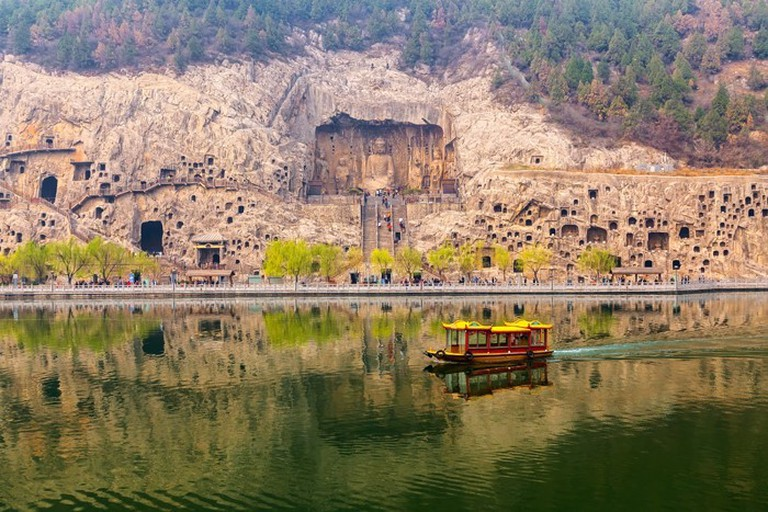 "Buddhist statues of the Longmen Grottoes in Luoyang, ""The Story of China"""