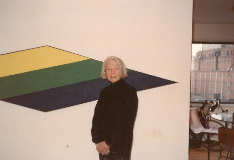 Cosgriff next to a painting by Kenneth Noland. Courtesy of J. Levine Auction & Appraisal.