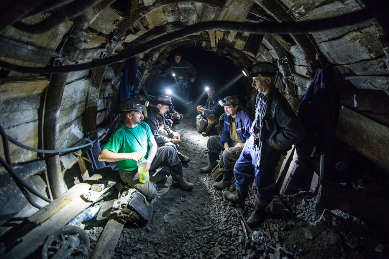 The miners take a short break, about 1,000 metres underground