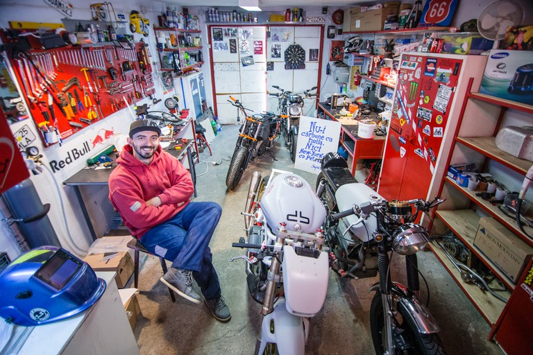 The garage is a social phenomenon in Petrila. Liviu, called Bibu, repairs, customises and builds motorcycles, raising money to move to the US