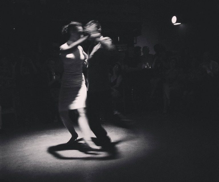 A couple dancing tango at Cafe Vinilo in Buenos Aires during a TangoTrips tour   Courtesy of TangoTrips