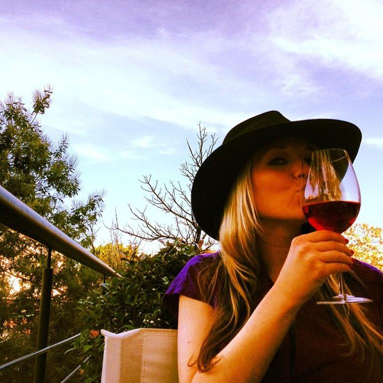 Tourist enjoying wine