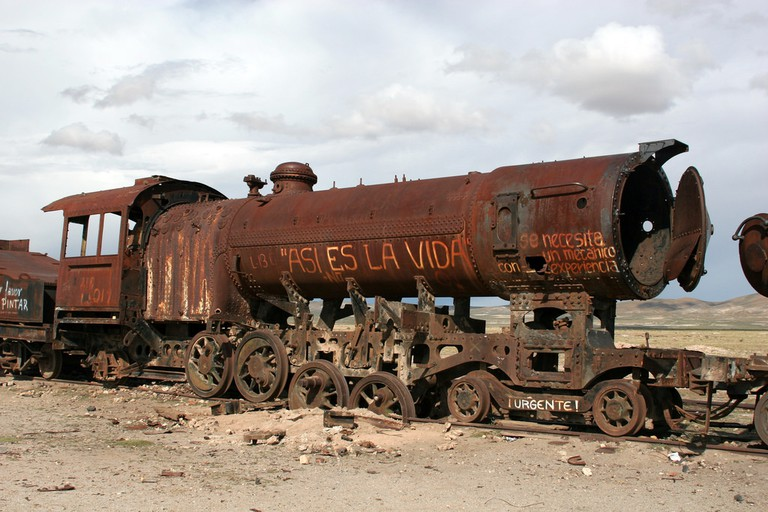 A train in Bolivia's train graveyard, reading 'Such is life'