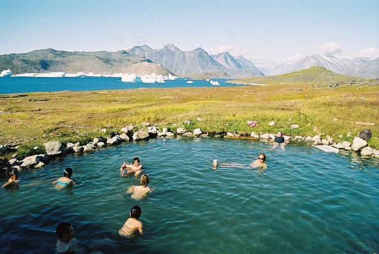 Bathers at Uunartoq hot springs / Svickova / Public domain / WikiCommons