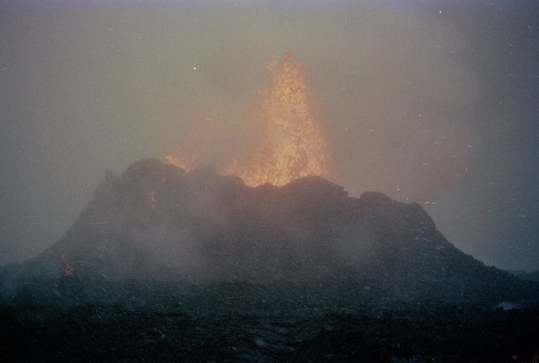 Lava erupting from Krafla during a snow storm / Roger Goodman / Flickr