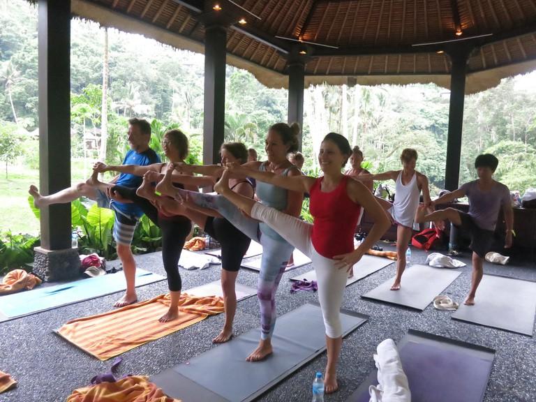 Indoor yoga class in Bali