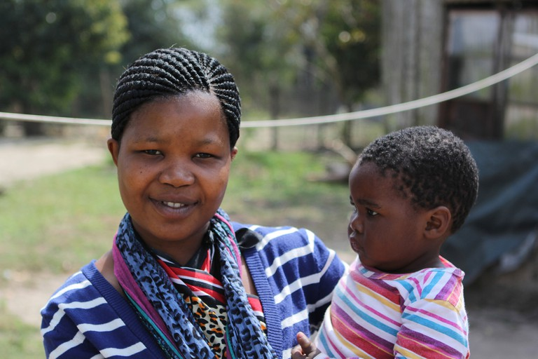 A Sangoma in Training with her Child