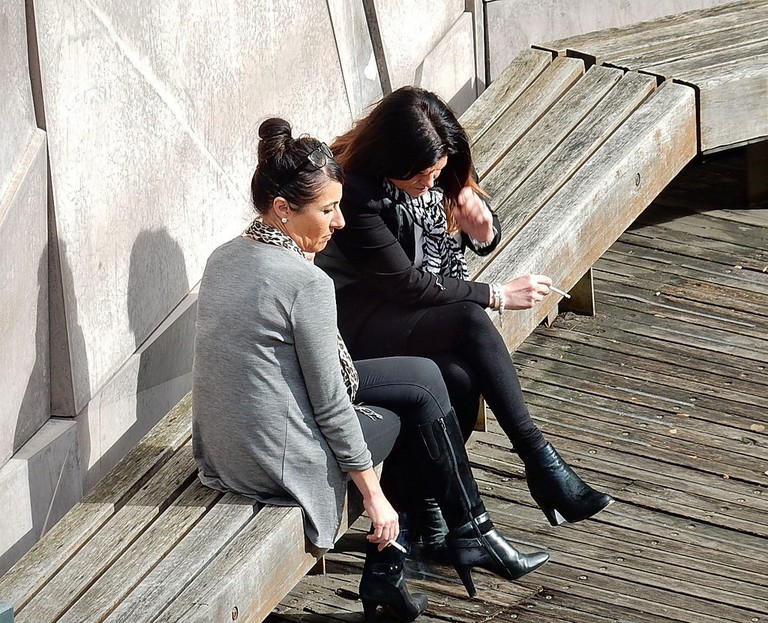 Two women on a 'smoko' break in Melbourne, Australia