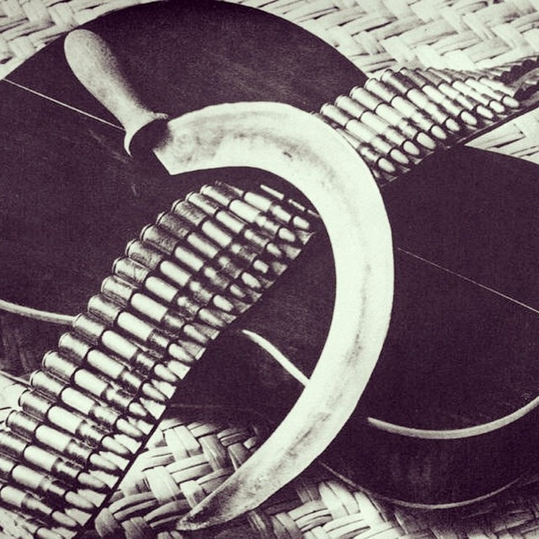 Guitar with bullets and sickle by Modotti
