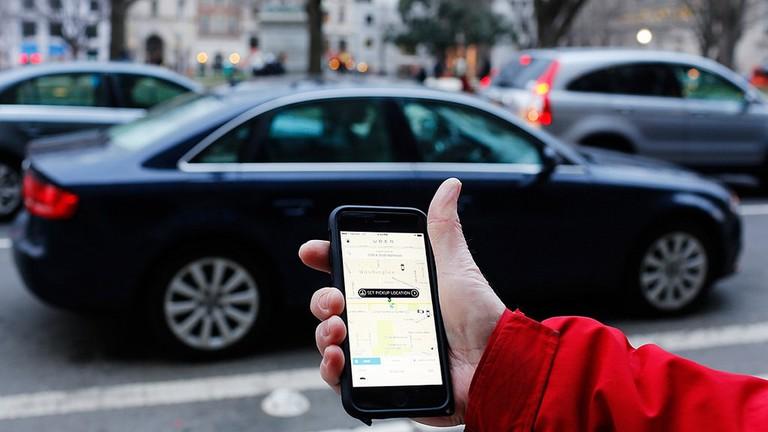 The Uber app on a smartphone / Mark Warner / Flickr
