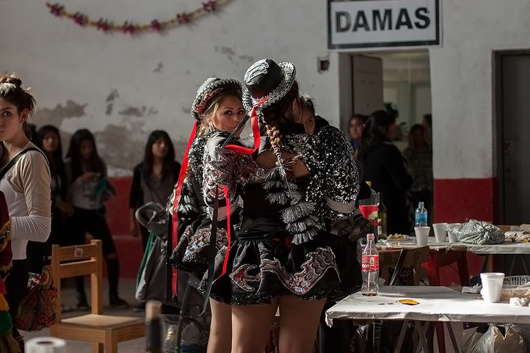 Two girls preparing to celebrate the Virgin of Copacabana Feast Day