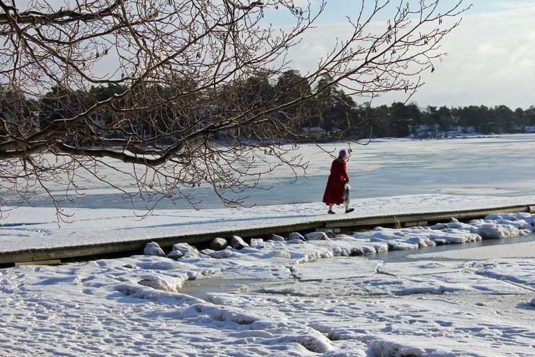 A person heading out ice swimming / Ilkka Jukarainen / Flickr