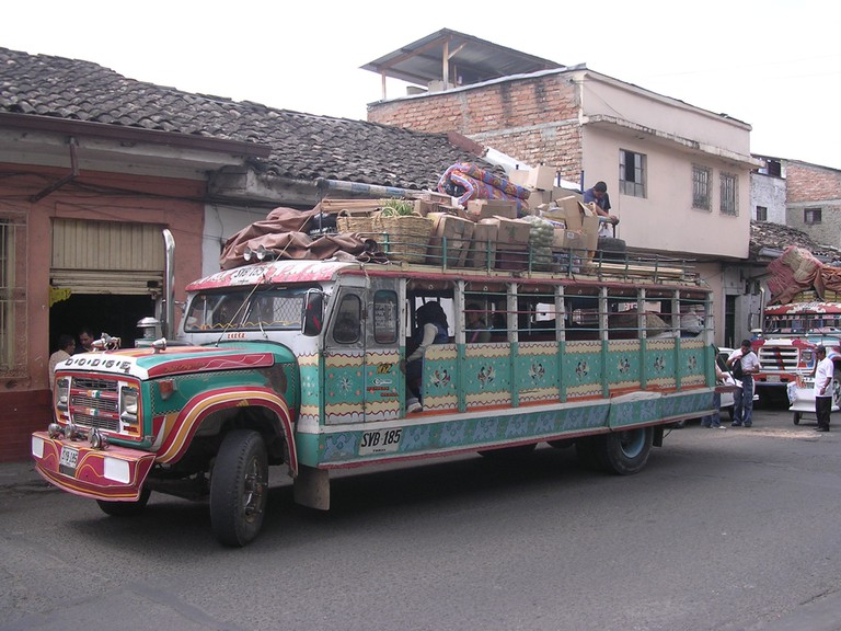 It doesn't get much more Colombian than a Chiva fully laden with goods and passengers