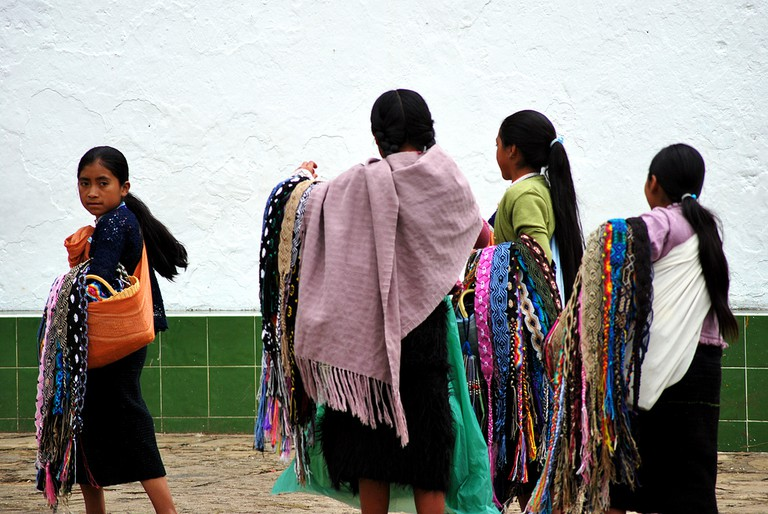 Women selling woven goods in Chamula