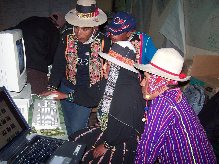 Indigenous Bolivians learning to use a computer