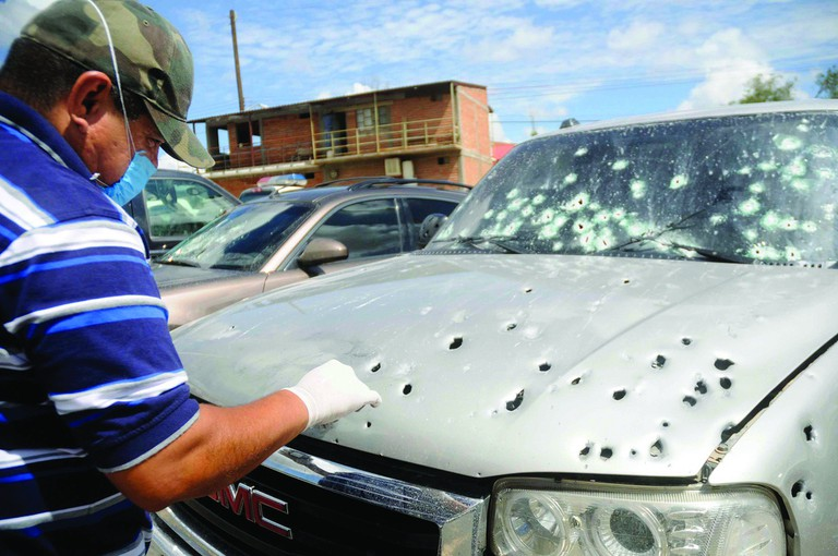 Drug violence in Mexico. This is the bullet ridden, drug-related hit remains of a car in Hermosillo, Sonora