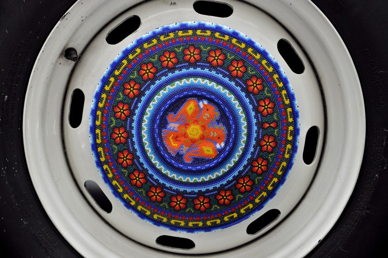 Huichol hubcaps on the Beetle