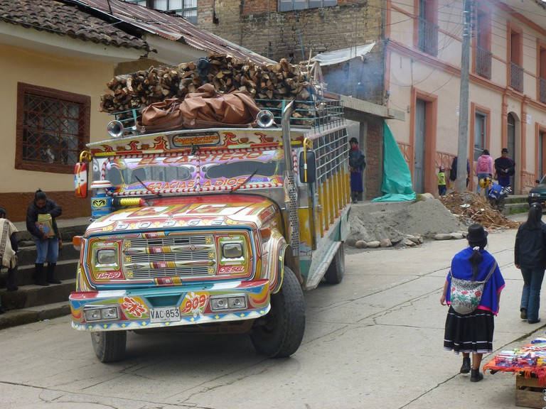 A traditional Colombian Chiva transporting firewood