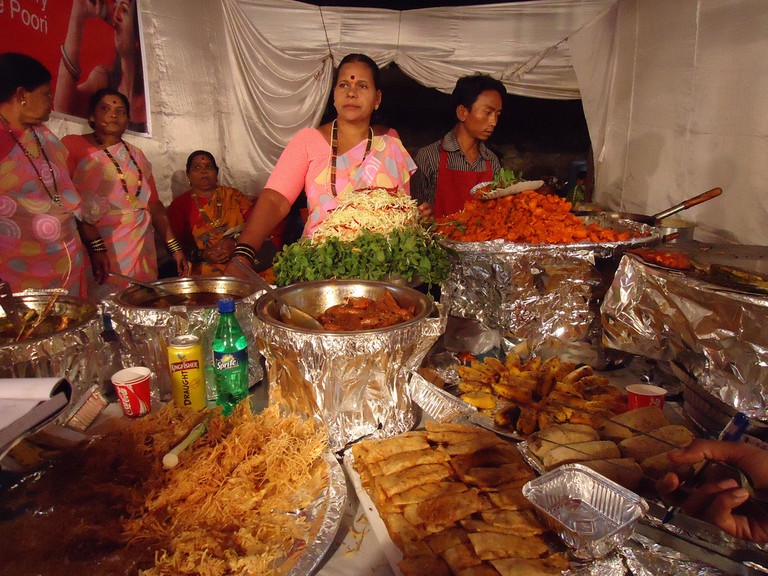 Women selling their best seafood dishes at the Koli food street fair