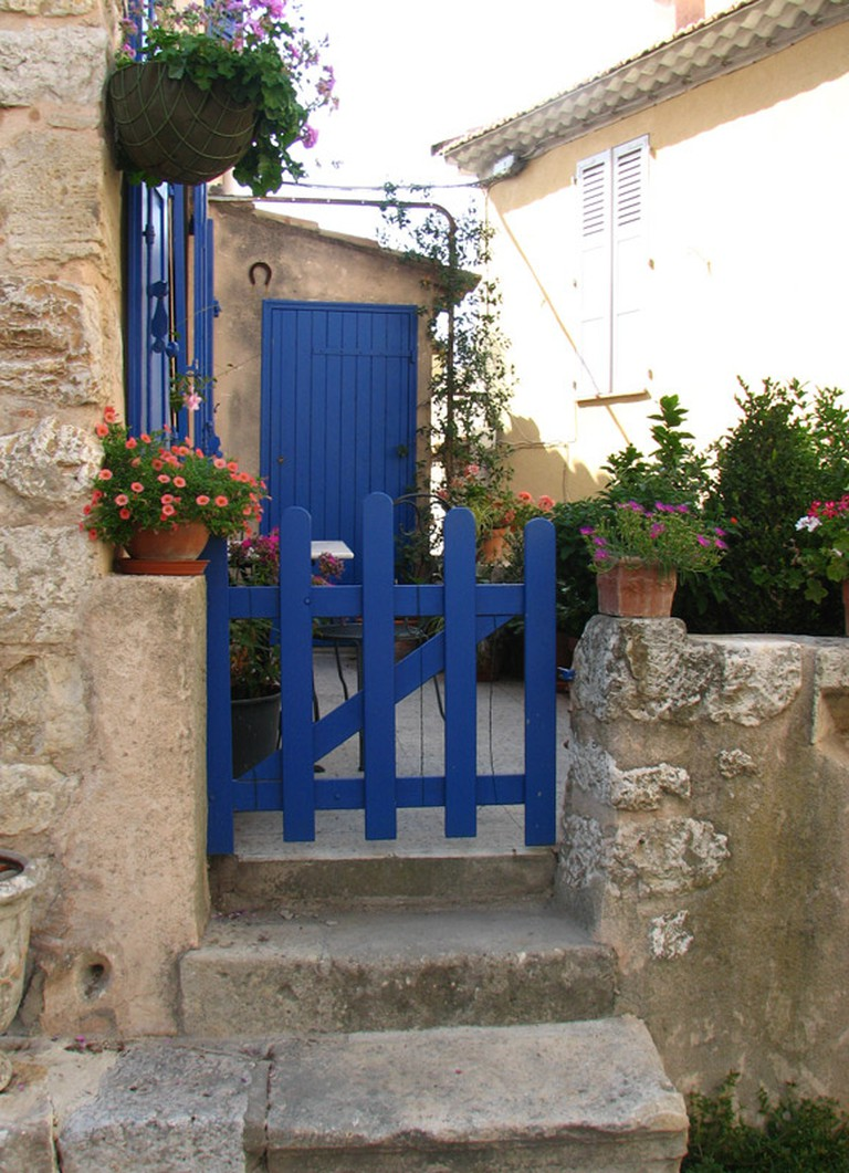 Traditional homes with Provençal blue shutters in Ventabren