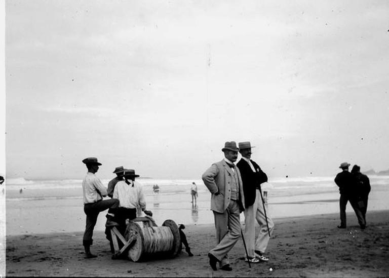 Two gentlemen conversing at the beach