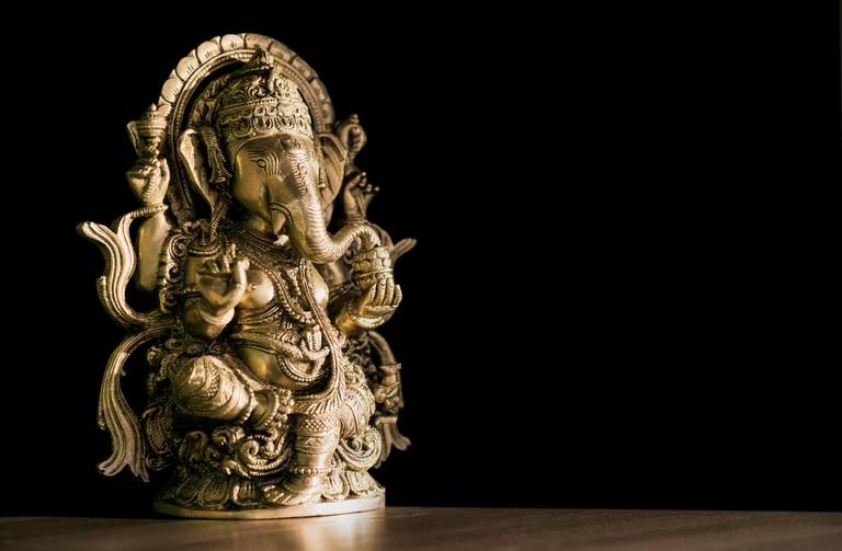A carved metal Ganesh idol