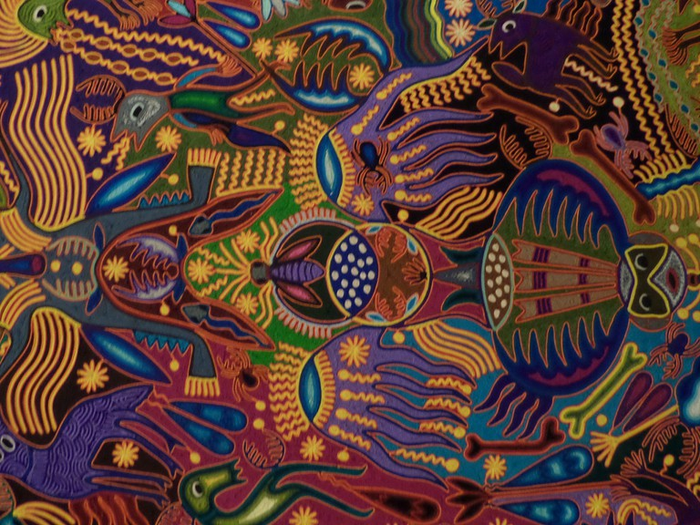 Heavily detailed Huichol art