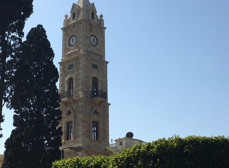 Clock tower behind the foliage of Manshiya Park