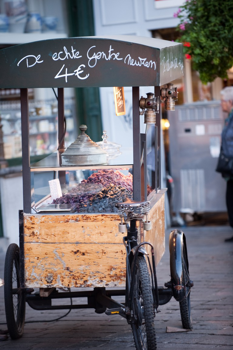 """One of two cuberdon carts competing for the tourist's attention. The line on top reads 'The real Ghent """"neuzekes""""' 